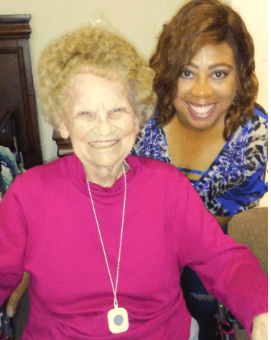 elderly woman and another mid age woman showing their beautiful smiles