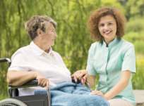 elderly woman in a wheelchair having a quality time with her caregiver